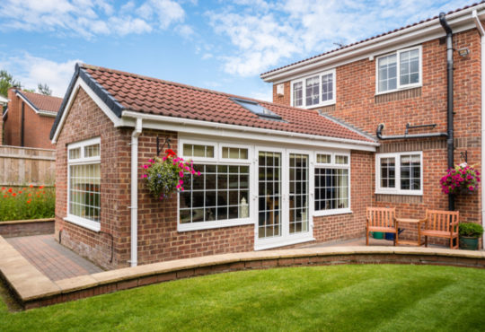 Modern conservatory extending into the garden
