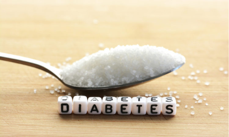 spoon of sugar and cubes spelling out Diabetes