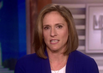 Portrait of Mimi Rocah in a news show