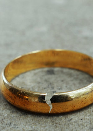 cracked wedding ring symbolizing separation