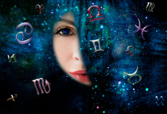 woman looking through hole into universe with star signs