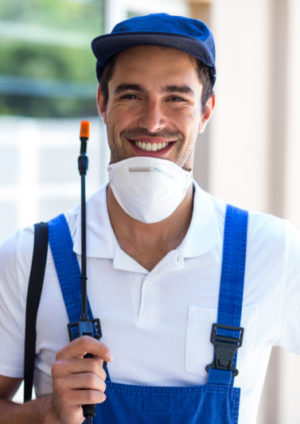 smiling young man doing pest control