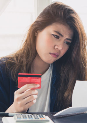 stressed young asian woman trying to find bad credit loan