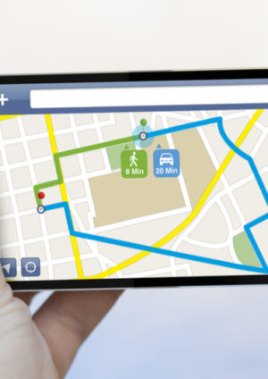 smartphone with map navigator app on the screen